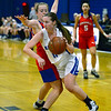 CARL RUSSO/Staff photo Methuen's Megan Melia maneuvers around Somerville defender towards the basket. Methuen defeated Somerville 61-47 in girls' basketball action Tuesday night. 2/18/2020
