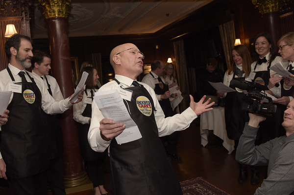 "TIM JEAN/Staff photo <br /> <br /> Mark Spencer, center, Andover Rotary Club member and owner of Water Analytics in Andover other local elected official and business leaders sings ""Be our Guests"" while being Superstar Servers during the Andover Cares fundraiser at the LANAM club in Andover.  2/27/20"
