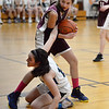 CARL RUSSO/Staff photo PMA's Eva Fabino hits the floor hard with a hand still on the ball as she fights for the bound with Fellowship's Avery Robichaud. Presentation of Mary Academy defeated Fellowship Christian Academy 51-43 in girls' basketball action Tuesday afternoon.  2/04/2020
