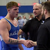 TIM JEAN/Staff photo <br /> <br /> Salem's Beau Dillon is congratulated by his coaches after pinning his opponent Anthony Tortura in the 220 pound finals during the Methuen Invitational.    2/1/20