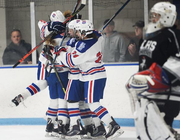 CARL RUSSO/Staff Photo Methuen/Tewksbury's players celebrate after Lydia Pendleton scores the first goal of the game. Methuen/Tewksbury defeated Longmeadow in OT 2-1 girls hockey tournament opener<br /> 2/26/2020.