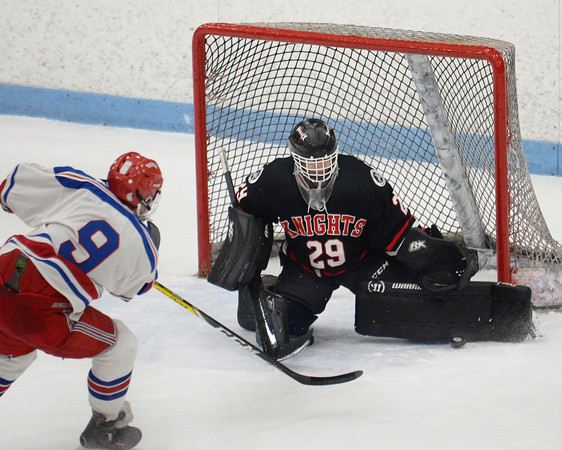 CARL RUSSO/Staff photo North Andover's Patrick Green makes the save on Tewksbury's Jason Cooke shot. <br /> <br /> North Andover defeated Tewksbury 3-2 in Div. 2 hockey quarterfinals at the Chelmsford Forum Friday night. 2/28/2020