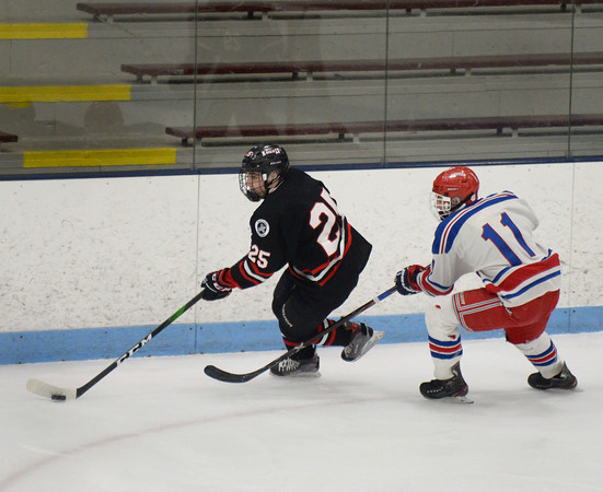 CARL RUSSO/Staff photo North Andover's Nick Herald races with the puck as Tewksbury's Campbell Pierce gives chase. <br /> <br /> North Andover defeated Tewksbury 3-2 in Div. 2 hockey quarterfinals at the Chelmsford Forum Friday night. 2/28/2020