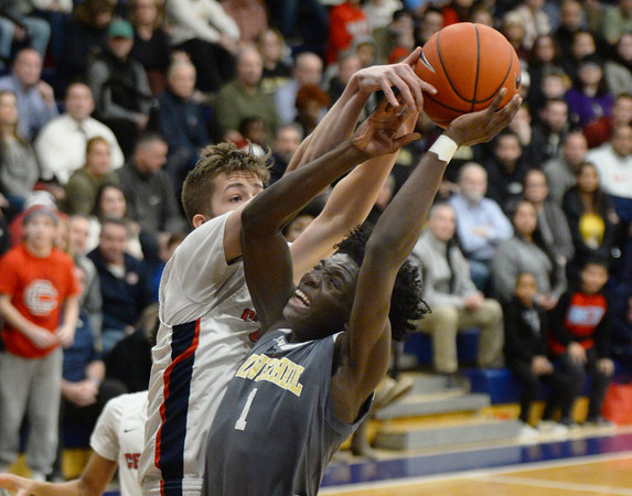 CARL RUSSO/Staff photo. Central's captain, Anthony Traficante stops Haverhill's Phillip Cunningnham's drive to the basket. Central Catholic defeated Haverhill in boys basketball in D1 North opener Monday night.  2/24/2020.