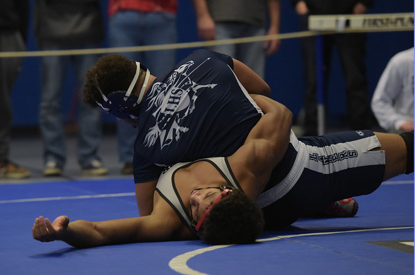 TIM JEAN/Staff photo <br /> <br /> Lawrence's Eric Sanchez, top, pinnes Xavier Ct., Marcelius Ruiz during the 195 pound finials match at the Methuen Invitational Saturday.    2/1/20