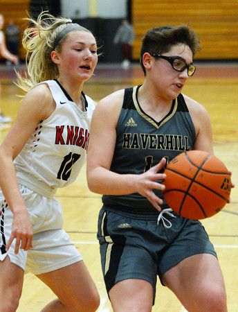 CARL RUSSO/Staff photo North Andover's Hannah Whipple plays tight defense against Haverhill's Kyalee Burdier. Haverhill defeated North Andover 52-47 in girls' basketball action. 2/7/2020.