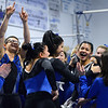 CARL RUSSO/Staff photo The Methuen Rangers surround their teammate and senior captain, Adiamis Ramos, right, to congratulate her after her performance on the bars during the Merrimack Valley Conference Gymnastic League Meet Thursday night on February 6, at A2 Gym and Cheer in Salem NH. <br /> <br /> The Rangers had more reasons to celebrate after capturing the MVC Division 2 championship. Ramos also captured the Senior Gymnast of The Year title.  2/6/2020