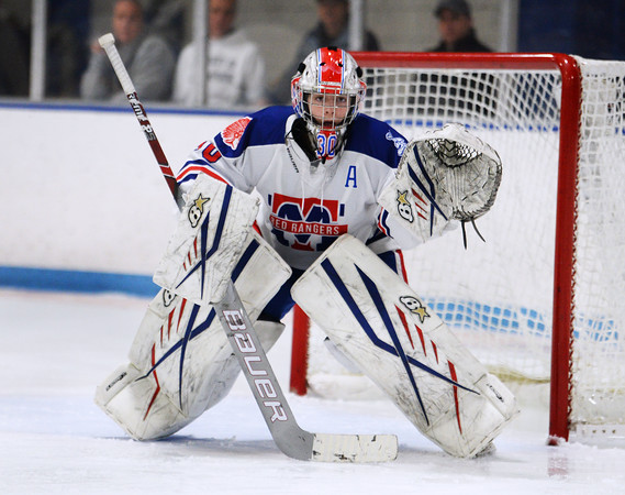 CARL RUSSO/Staff Photo Methuen/Tewksbury's goalie, Kaia Hollingsworth makes the save in the second period. Methuen/Tewksbury defeated Longmeadow in OT 2-1 girls hockey tournament opener. 2/26/2020.