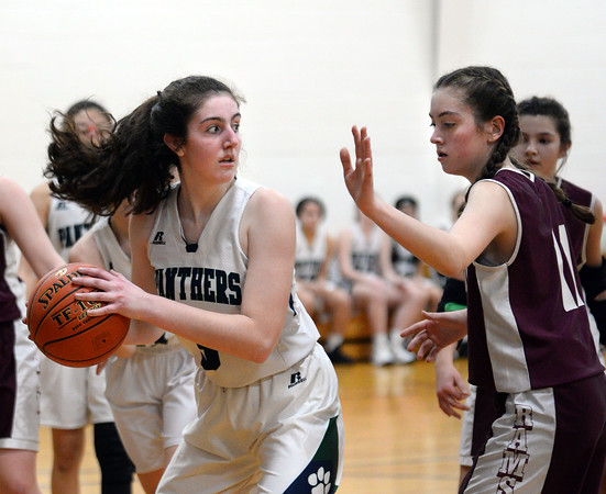 CARL RUSSO/Staff photo PMA's Sara D'Agostino comes up with the rebound and looks to pass as Fellowship's Jessica Campo defends. Presentation of Mary Academy defeated Fellowship Christian Academy 51-43 in girls' basketball action Tuesday afternoon. 2/04/2020