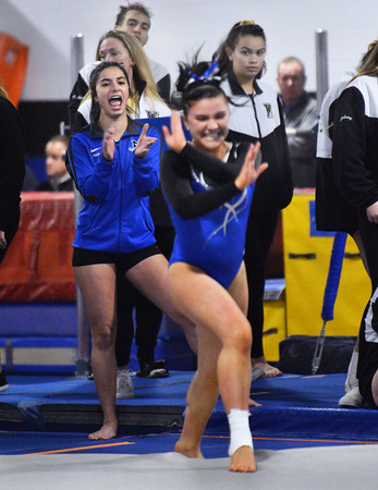 CARL RUSSO/Staff photo Methuen junior, Grace Pappalardo cheers for her teammate, Molly Beeley as she performs her floor routine. Beeley is also a junior. <br /> <br /> The Merrimack Valley Conference Gymnastic League Meet was held Thursday night on February 6, at A2 Gym and Cheer in Salem NH. 2/6/2020 20.