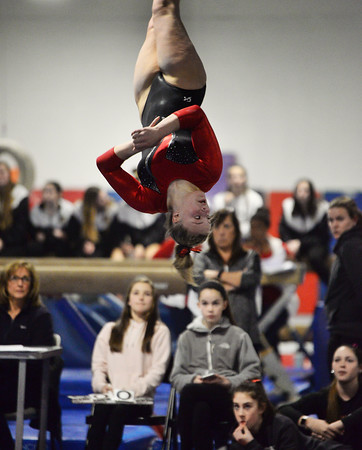 CARL RUSSO/Staff photo North Andover sophomore, Kasey Burke is captured completely upside down as she somersaults during her floor routine. For the second straight season, Burke, ruled the Merrimack Valley Conference Gymnastics Championship. <br /> <br /> She won three individual events on the way to repeating as the all-around champion with a score of 37.95 at the Merrimack Valley Conference Gymnastic League Meet, held Thursday night on February 6, at A2 Gym and Cheer in Salem NH. 2/6/2020