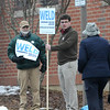 TIM JEAN/Staff photo <br /> <br /> Derry residents walk pass candidate supporters before voting at the Gilbert H. Hood Middle School during the New Hampshire primary.     2/11/20