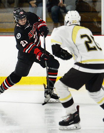 CARL RUSSO/Staff photo North Andover's Andrew Perry shoots on net as Haverhill's Jack Waligora defends. North Andover defeated Haverhill 6-2 in boys' hockey action. 2/05/2020