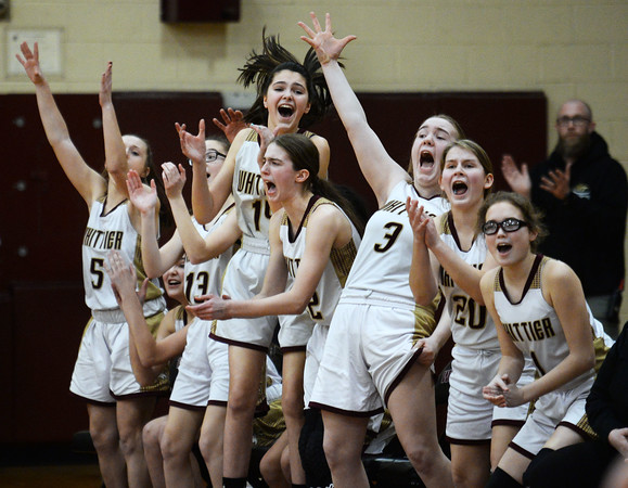 CARL RUSSO/Staff Photo Whittier's bench erupts after a three point basket as the Wildcats keep the score close in the first half. Winthrop high defeated Whittier Tech. 55-39 in Div. 3 North quarterfinals in girls basketball action Thursday night. 2/27/2020
