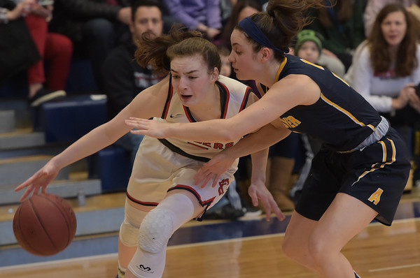 TIM JEAN/Staff photo <br /> <br /> Andover's Shea Krekorian, right, defends against Central's Claire Finney during girls basketball Division 1 North quarterfinals.    2/29/20