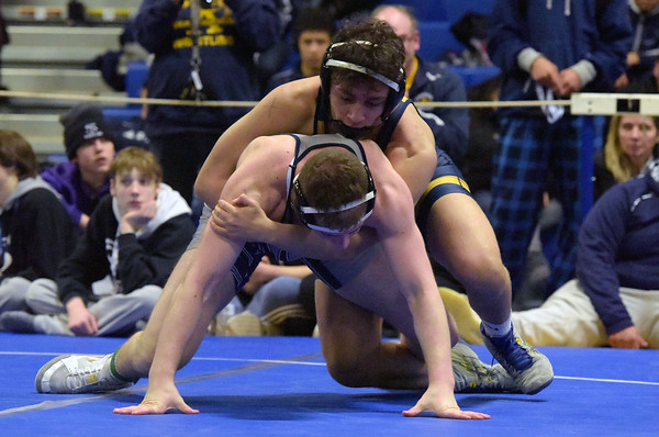 TIM JEAN/Staff photo <br /> <br /> Andover's Elias Maita, top, wrestlers against St. John's Prep Achilles Gikas during the 160 pound final in the MIAA Division 1 North sectional at Methuen High School.   2/15/20