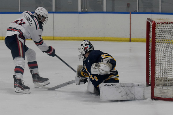 TIM JEAN/Staff photo <br /> <br /> Central's Aidan O'Connell scores on a break away against Andover during a boys hockey game at the ICenter in Salem NH. Andover won 5-3.     2/8/20