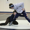 MIKE SPRINGER/Staff photo<br /> Siblings Marisol and Colin Nugent work out together during wrestling practice Tuesday at Phillips Acadamy in Andover.<br /> 2/4/2020