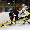 CARL RUSSO/Staff photo North Andover's Ryan Bianavilla and Haverhill's Jack Sullivan fight for the puck along the boards. North Andover defeated Haverhill 6-2 in boys' hockey action. 2/05/2020