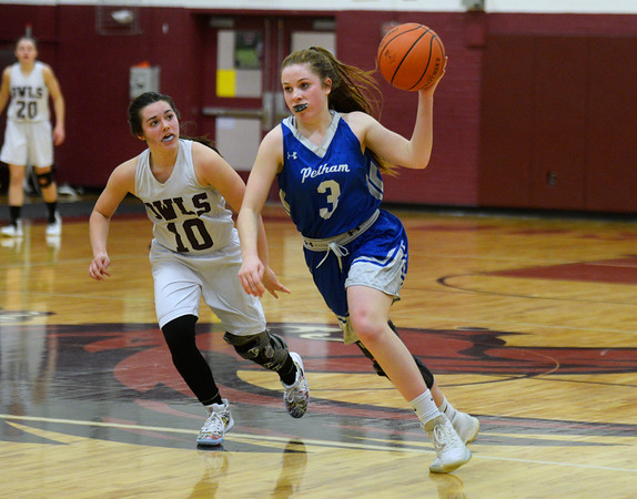 CARL RUSSO/Staff photo Pelham's Abbey Schwab steals the ball as Timberlane's Hannah Collins gives chase. Pelham defeated Timberlane 52-21 in girls' basketball action Monday night. 2/17/2020. .