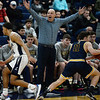 CARL RUSSO/Staff Photo. Andover head coach, David Fazio wants a foul call as Lawrence's captain Brandon Goris, left attempts to steal the ball from Andover's captain, Charlie McCarthy who was able to control the ball on the line. Lawrence defeated  Andover 60-54 in boys Basketball action in the D1 North tournament. 2/25/2020.