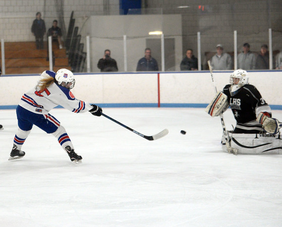 CARL RUSSO/Staff Photo Methuen/Tewksbury's Lydia Pendleton scores the first goal of the game. Methuen/Tewksbury defeated Longmeadow in OT 2-1 girls hockey tournament opener.	2/26/2020.