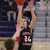 MIKE SPRINGER/Staff photo<br /> Central Catholic's Nate Godin goes up for a shot against Jack Perry of St. John's during varsity basketball action Sunday in Danvers. <br /> 2/2/2020