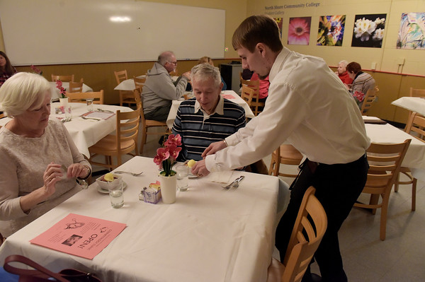TIM JEAN/Staff photo <br /> <br /> Collin Hate, right, of Groveland takes care of customers Marie and Brendan Lacey, of Gloucester as they enjoy a lunch in the student-run Beacon Cafe at North Shore Community College's Middleton campus.    1/30/20