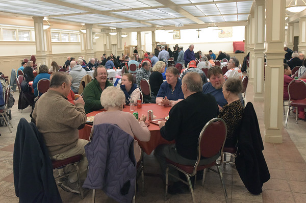TIM JEAN/Staff photo <br /> <br /> Hundreds attended the annual Haverhill Sons of Italy pasta dinner in the basement of All Saints Church. The dinner featured salad, pasta, bread, and meatballs made by Larry Gaiero, the winner of last year's meatball cooking contest.    2/22/20