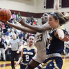 CARL RUSSO/Staff Photo Whittier's Grace Efosa-Aguebor drives to the basket against Winthrop's Maddie Stiglets. Winthrop defeated Whittier Tech. 55-39 in Div. 3 North quarterfinals in girls basketball action Thursday night. 2/27/2020