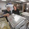 MIKE SPRINGER/Staff photo<br /> Jane Burns, right, Andover's new director of elder services, checks with kitchen worker Tina Solari on the day's meal Monday at the Andover Senior Center.<br /> 2/3/2020