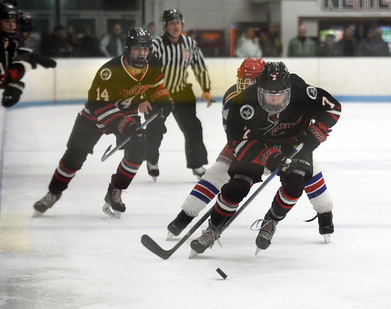 CARL RUSSO/Staff photo North Andover's Adam Heinze races with the puck.<br /> <br /> North Andover defeated Tewksbury 3-2 in Div. 2 hockey quarterfinals at the Chelmsford Forum Friday night. 2/28/2020
