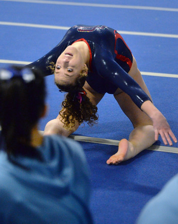 CARL RUSSO/Staff photo Central Catholic's senior captain, Regina Dieli strikes a pose as she competes in the floor routine. <br /> <br /> The Merrimack Valley Conference Gymnastic League Meet was held Thursday night, February 6, at A2 Gym and Cheer in Salem NH. 2/6/2020.