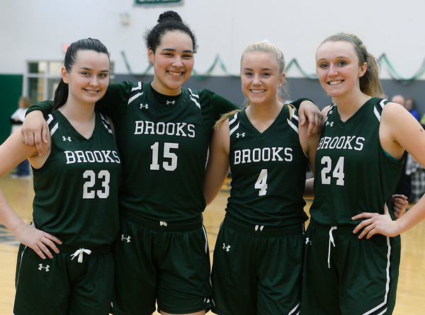 """CARL RUSSO/Staff Photo. On February 26, Brooks School defeated St. Mark's  81-25 in girls basketball action during senior night. <br /> <br /> The seniors, from left, Jennifer Connolly of Melrose, Sydney Robinson of Wallingford, CT and Molly Madigan and Brooke Cordes both of North Andover. Before the end of this game or the season, it was noted that Cordes had recently scored her 1,000th point. 2/26/2020 <br /> <br /> <br /> DEDHAM — North Andover's Brooke Cordes and Molly Madigan are two of the four seniors that have been with the Brooks girls basketball program for the past four years.<br /> <br /> Over that stretch, they've experienced their fair share of bad times.<br /> <br /> They were a part of Brooks' last playoff team as freshmen that ended up losing in the first round of the tournament. And over the last two years, the program went a combined 12-28.<br /> <br /> But Sunday evening, they got to end their high school careers as champions.<br /> <br /> Sophomores Taina Mair (19 points) and Samantha Dewey (16 points, tourney MVP) led the way, as top-seeded Brooks took down St. Luke's, 63-47, to claim its first NEPSAC Class B championship since 2006.<br /> <br /> And as the team got to celebrate on the Noble & Greenough court, for the seniors, the win was finally some validation for all of the hard work they've put in over the past four years.<br /> <br /> """"It's awesome,"""" said Madigan, who scored all 10 of her points in the second half. """"For the past few years we didn't make the playoffs, but this is the perfect way to end it.""""<br /> <br /> That's especially true when you consider that Madigan and Cordes — who'll be attending Villanova — both will not be playing basketball in college.<br /> <br /> But they certainly made their final high school memory an unforgettable one.<br /> <br /> """"This was the perfect way to end it,"""" said Cordes. """"It just proves that if you keep your head down and you continue to work, everything's going to be okay. I couldn't think of a """