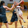 CARL RUSSO/Staff photo North Andover captain, Norah Connors drives to the basket surrounded by Haverhill defenders. Haverhill defeated North Andover 52-47 in girls' basketball action. 2/7/2020.