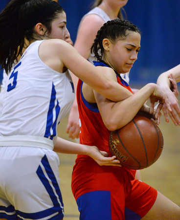 CARL RUSSO/Staff photo Methuen's Stephanie    <br /> Tardugno fights for the loose ball with Somerville <br /> defender Methuen defeated Somerville 61-47 in girls' basketball action Tuesday night. 2/18/2020.