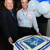 CARL RUSSO/staff photo. Lawrence High, class of 1969, held their 50th. reunion on Saturday, October 12 at Salvatore's Restaurant in Lawrence. Ken Hamilton, left, of Andover, class president and Phil Marino, of Exeter N.H. class vice-president admire the cake. <br /> <br /> Around 100 classmates attended and celebrated together. The class graduated 415 seniors in 1969. A memorial tree with photos plus an empty chair honored the classmates who have passed away.  10/12/2019