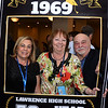 CARL RUSSO/staff photo. Lawrence High, class of 1969, held their 50th. reunion on Saturday, October 12 at Salvatore's Restaurant in Lawrence. Classmates, from left, Paula Najem Senia of Atkinson N.H., Kathleen Killeen Scanlon of Salem N.H. and Mario ''Butch'' DiMauro of Methuen have a memorable photo of the reunion taken. <br /> <br /> Around 100 classmates attended and celebrated together. The class graduated 415 seniors in 1969. A memorial tree with photos plus an empty chair honored the classmates who have passed away.  10/12/2019