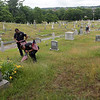 TIM JEAN/Staff photo<br /> <br /> Lawrence Police Chief Roy Vasque and Lt. Maurice Aguiler place a flag on veterans grave at the Bellevue Cemetery in Lawrence. Behind them is LT. Michael McCarthy also placing flags on the veterans graves.       7/1/20