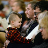 CARL RUSSO/Staff photo. Benjamin Polizzotti, 2, plays with the program as his father, Steven Polizzotti of Dracut enjoys listening to the singing during the  Christmas Eve Carol Sing, sponsored by the Heritage Baptist Church in Windham and held at the historic Searles School and Chapel. <br /> <br /> Around 125 members of the church and guest enjoyed singing or just listening to the traditional Christmas carols. 12/24/2019