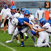 TIM JEAN/Staff photo<br /> <br /> Salem's Jacob Brady drags a few Londonderry defenders as he runs for a short gain during a football game at Londonderry High School. Londonderry defeated Salem 16-0.     10/3/20