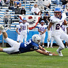 TIM JEAN/Staff photo<br /> <br /> Salem's Noah Poulin (52) dives but can't make the tackle of Londonderry's Eric Raza as he runs for a short gain during a football game at Londonderry High School. Londonderry defeated Salem 16-0.     10/3/20