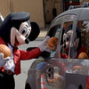 TIM JEAN/Staff photo<br /> <br /> A character dressed as a famous mouse passes out pumpkins to children at the drive through pumpkin patch during Methuen Day at the Loop Saturday.    10/3/20