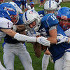 TIM JEAN/Staff photo<br /> <br /> Salem's Aidan McDonald (15) fights hard for more yardage  as he is tackled by Londonderry's Londonderry's Robbie Derek, right, and Aiden O'Loughlin, left, during a football game at Londonderry High School. Londonderry defeated Salem 16-0.     10/3/20