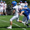 TIM JEAN/Staff photo<br /> <br /> Londonderry running back Hayden Austen runs for the first down against Salem during a football game at Londonderry High School. Londonderry defeated Salem 16-0.     10/3/20