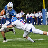TIM JEAN/Staff photo<br /> <br /> Salem's Aidan McDonald (15) looks to get past Londonderry's Lucas Seaman as he dives to make a play during a football game at Londonderry High School. Londonderry defeated Salem 16-0.     10/3/20