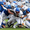 TIM JEAN/Staff photo<br /> <br /> Salem's defense gang tackles Londonderry's Eric Raza for a loss during a football game at Londonderry High School. Londonderry defeated Salem 16-0.     10/3/20