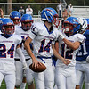 TIM JEAN/Staff photo<br /> <br /> Londonderry quarterback Dylan McEachern (14) celebrates scoreing a touchdown against Salem with his teammates during a football game at Londonderry High School. Londonderry defeated Salem 16-0.     10/3/20