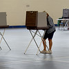 TIM JEAN/Staff photo<br /> <br /> An Andover resident fills out a ballots before voting in the Richard J. Collins Field House at Andover High during the state primary.  9/1/20