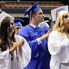 TIM JEAN/Staff photo. Graduates stand and applaud after Madeleine Doris sings and plays the piano during Londonderry High School graduation ceremony at the Verizon Wireless Arena in Manchester.  6/12/15